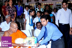 Omare Kashyapa thero, Former Adviser to the President, Shastrapathi, chief prelate of Sri Rohana Chapter and Pariwenadhipathy of Vidya Nikethana Pirivena at Sapugoda, Kaburupriya being presented with the first set of new products by Beam Hela Osu Lanka Company.